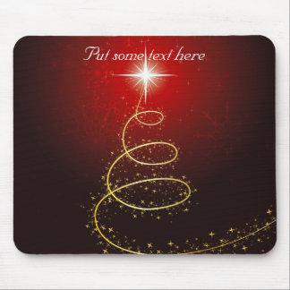 Árbol de navidad de oro abstracto en brillar inten tapete de ratones