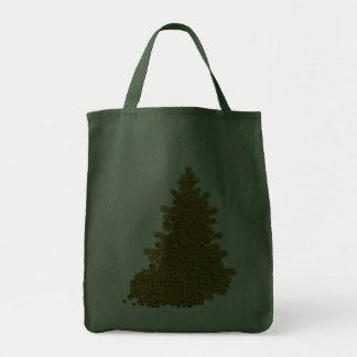 Árbol de navidad del oro con los regalos bolsas