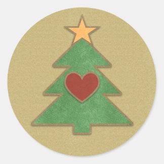 Árbol de navidad del país del estilo del libro de pegatina redonda