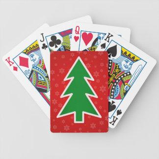 Árbol de navidad en fondo rojo baraja de cartas