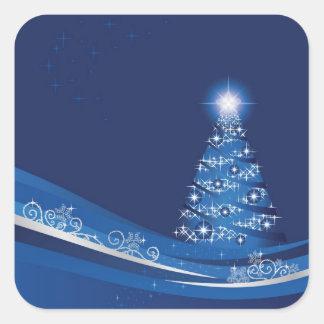 Árbol de navidad en un pegatina azul del