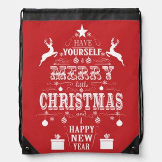 árbol de navidad moderno de la tipografía del mochilas