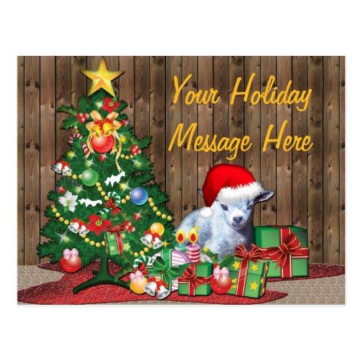 Árbol de navidad y cabra del bebé postal