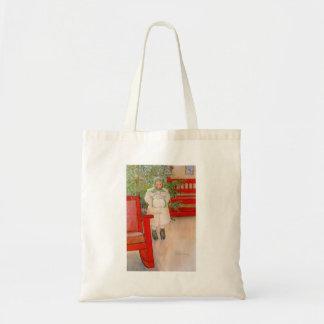 Árbol de navidad y niño en pieles bolsas