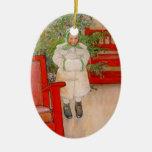 Árbol de navidad y niño en pieles adorno ovalado de cerámica
