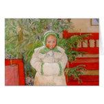 Árbol de navidad y niño en pieles felicitación