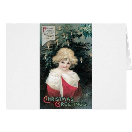 Árbol de navidad y niño tarjeta de felicitación