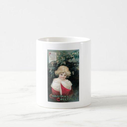 Árbol de navidad y niño tazas de café