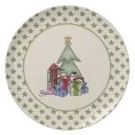 Árbol de navidad y placa lindos de los presentes plato de comida