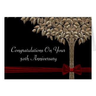 Árbol de oro con la cinta y el arco rojos Congrats Felicitaciones