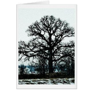 Árbol majestuoso en la nieve felicitacion