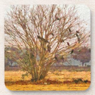 Árbol por completo de pájaros grandes posavaso