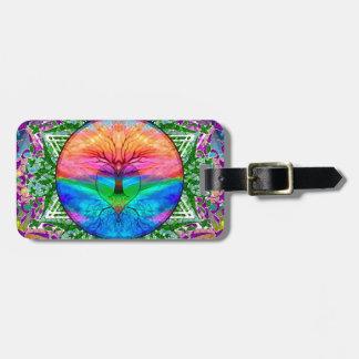 Árbol que calma de la vida en colores del arco etiquetas maletas