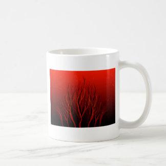 Árbol rojo con la sombra negra taza de café