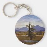 Árbol solitario (paisaje del pueblo en luz de la m llavero redondo tipo pin