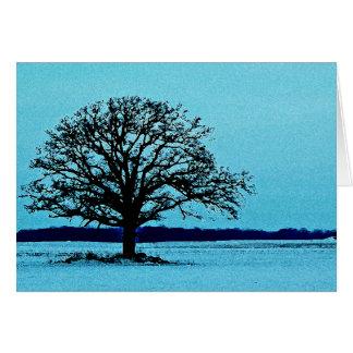 Árbol solo en un paisaje del invierno felicitación