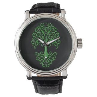 Árbol tribal del verde de la vida en negro reloj