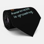 Árbol y rompecabezas de la conciencia del autismo corbata