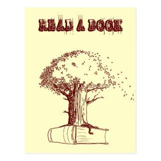 Árbol y un libro postal