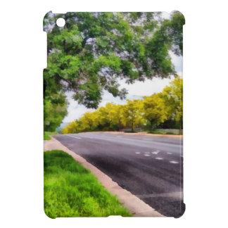 Árboles a ambos lados de un camino