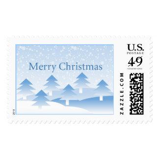 Árboles de navidad y copo de nieve azules sellos