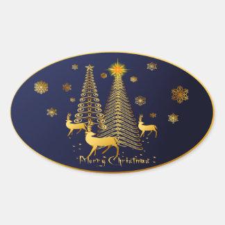 Árboles de navidad y reno del oro pegatina ovalada