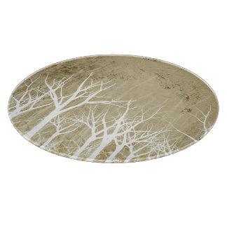 Árboles desnudos del invierno tablas para cortar