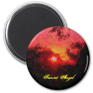 Árboles en el imán del ángel de la puesta del sol