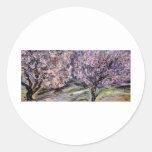 Árboles en flor etiqueta redonda