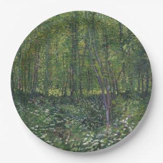 Árboles y maleza de Vincent van Gogh