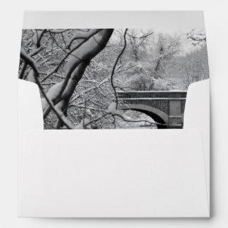 Arch Bridge over Frozen River in Winter Envelope