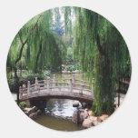 Arched Bridge in peaceful park Classic Round Sticker