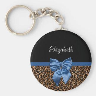 Arco azul elegante y nombre del estampado leopardo llavero redondo tipo pin