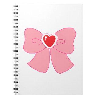 Arco borroso rosado del corazón libros de apuntes