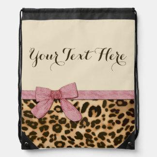 Arco de los rosas bebés del estampado leopardo del mochila