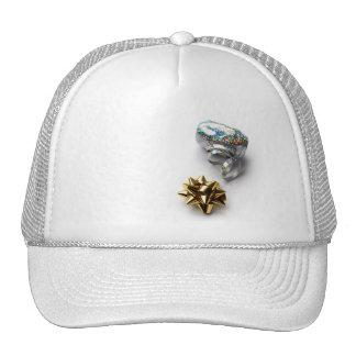 Arco del papel de regalo y gorra brillantes de la