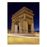 Arco del Triunfo de l'Étoile en tiro de la noche d Postal