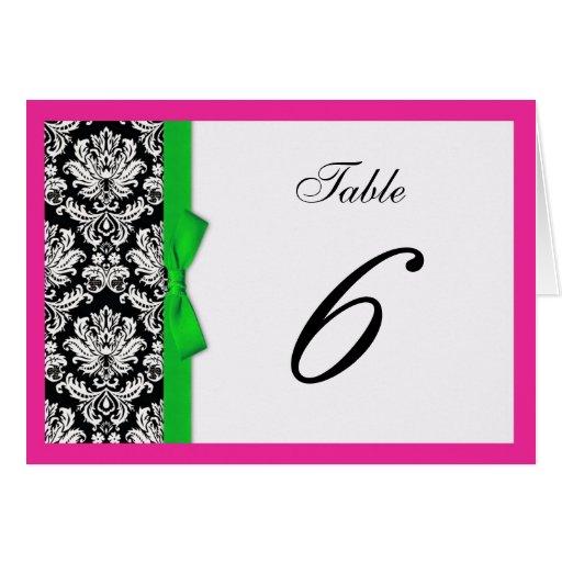 Arco del verde del damasco con número de la tabla tarjeta de felicitación