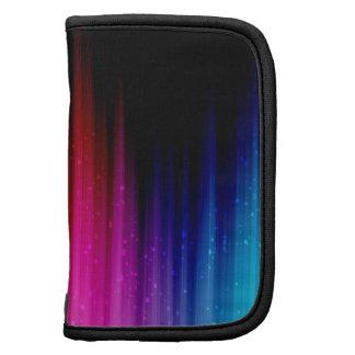 Arco iris bombeado encima del caso en folio organizador