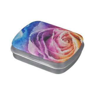 Arco iris de la acuarela subió latas de caramelos