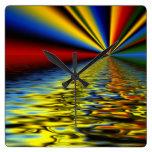 Arco iris de los colores reflejados sobre el agua  reloj