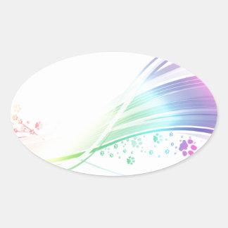 Arco iris de Pawprint Pegatina Ovalada