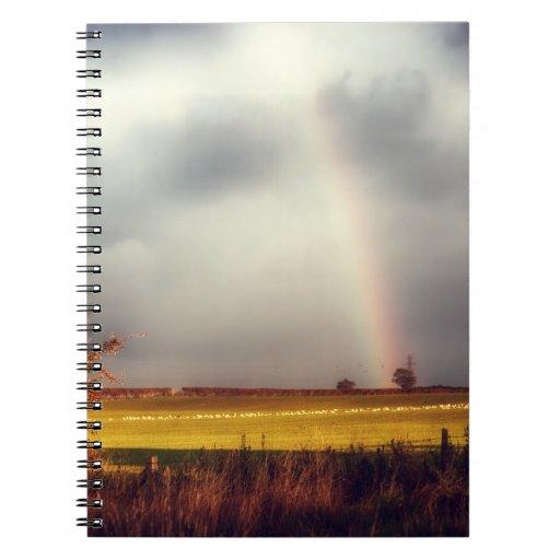 Arco iris del día lluvioso libros de apuntes