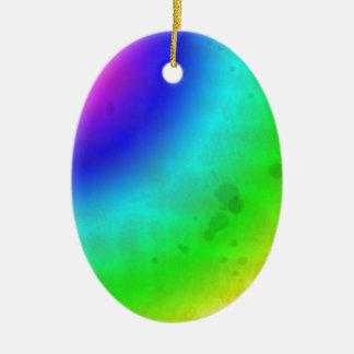 Arco iris manchado agua adorno navideño ovalado de cerámica