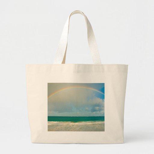 Arco iris sobre el océano bolsa tela grande
