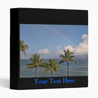 Arco iris sobre el océano con las palmeras