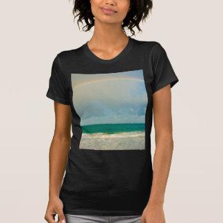 Arco iris sobre el océano playera