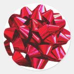 Arco rojo brillante pegatina redonda