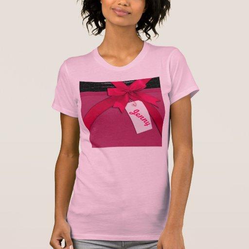 Arco rosado de moda en el cuero negro y rosado camisetas