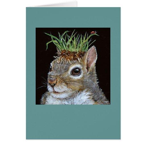 ardilla con la tarjeta del grupo de la hierba